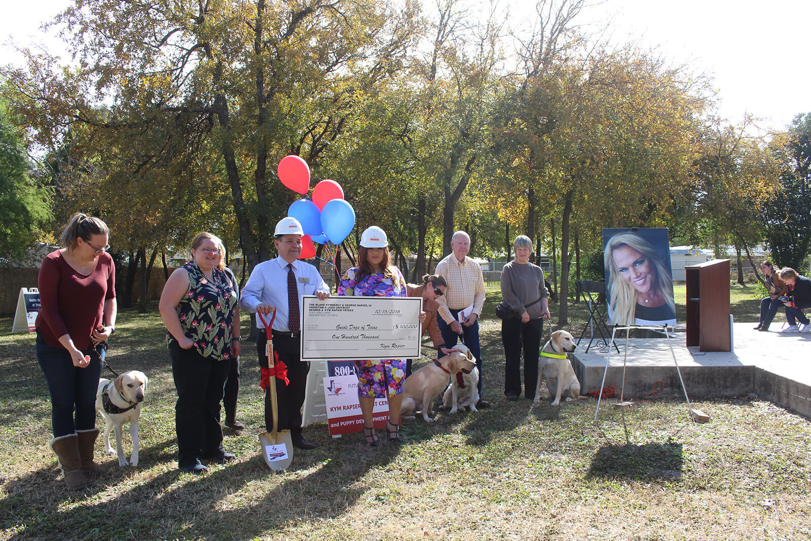 Guide Dog Board and Staff celebrating the check presentation for the Kym Rapier Sight Center and Puppy Enrichment Center with her spokesperson Karina Villa.